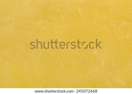 Juicy yellow pineapple pulp macro closeup texture background - stock photo