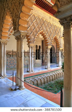 JUL 11 2015: Detailed Moorish decorations on the patio of the Alcazar of Seville in Seville, Andalusia, Spain