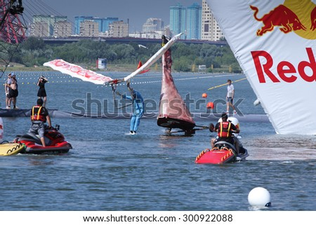 JUL 26, 2015 MOSCOW: Red bull flugtag day. Red Bull Flugtag is an event in which competitors attempt to fly homemade human-powered flying machines. - stock photo