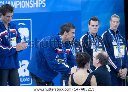 Jul 26 2009; Rome Italy; Michael Phelps (USA) gets his gold medal from the guest of honour Prince Albert of Monaco at the prize giving ceremony for the mens 4 x 100m freestyle event