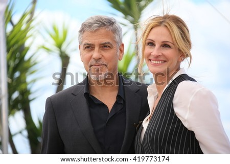 Julia Roberts, George Clooney attend the 'Money Monster' photocall during the 69th annual Cannes Film Festival at the Palais des Festivals on May 12, 2016 in Cannes, France. - stock photo