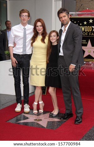 Julianne Moore and family at Julianne Moore's Star on the Hollywood Walk of Fame Ceremony, Hollywood Walk of Fame, Hollywood, CA 10-03-13 - stock photo