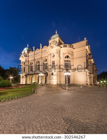 Juliusz Slowacki theatre in Krakow, Poland. Night view of illuminated XIXth century building, built in eclectic style.