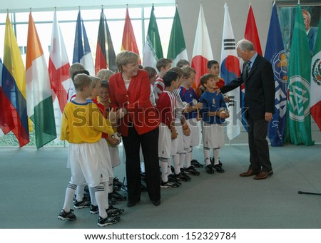 JULY 6, 2006 - BERLIN: Chancellor Angela Merkel with German soccer legend Franz Beckenbauer and children at a reception in the Chanclery in Berlin.