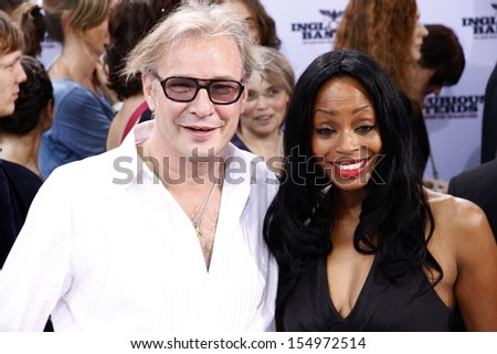 "JULY 28, 2009 - BERLIN: Leander Haussmann, Rosalind Baffoe at the German premiere of the movie ""Inglorious Basterds"", Theater am Potsdamer Platz, Berlin."