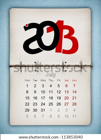 July 2013 Calendar, open old notepad on blue paper - stock photo