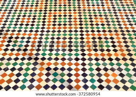 JULY 09, 2015: Ceramic tiles on the floor of the Bou Inania Madrasa in Meknes, Morocco