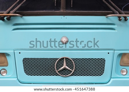 July 13, 2016 : Close up of the logo of Mercedes-Benz on the old van front in blue. Bangkok, Thailand