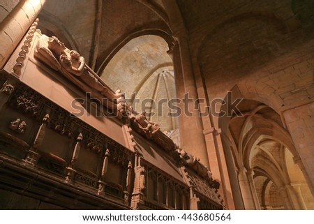 July 15, 2015: Detail of stone statues decorating the graves of the Catalan Monarchs inside the Church of the Royal Abbey of Santa Maria de Poblet (Poblet Monastery) in Catalonia, Spain