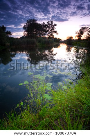 July evening by the river - stock photo
