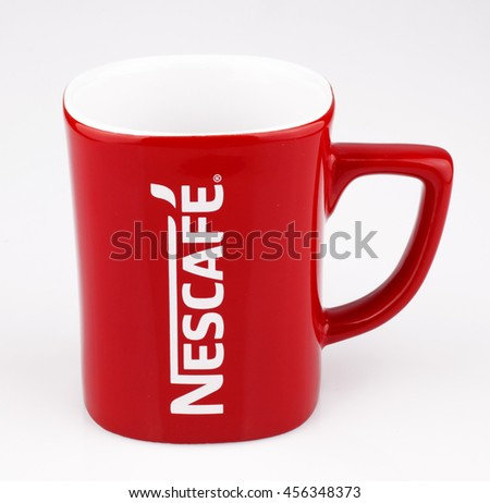 July 2016, Lahore: Promotional red Nescafe mug on gray background
