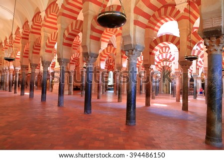 July 12, 2015: Long row of Moorish columns and arches from the Cathedral (Mosque / Mezquita) in Cordoba, Andalusia, Spain