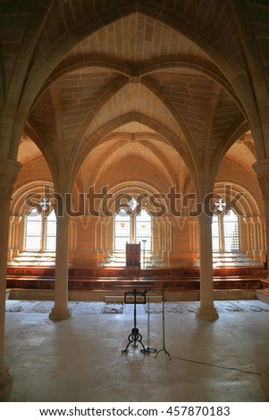 July 15, 2015: Medieval architecture with Gothic arches of the meeting room at the Royal Abbey of Santa Maria de Poblet (Poblet Monastery) in Catalonia, Spain