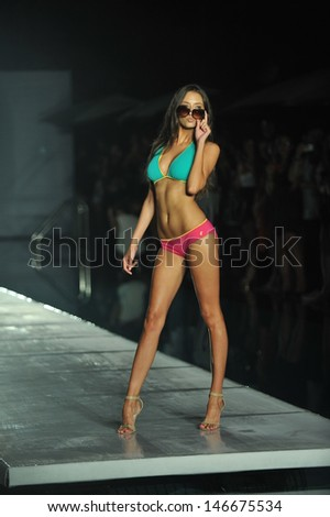 JULY 18 MIAMI FLORIDA: Model walking runway during Barraca Chic swimwear show at SLS hotel on July 18, 2003 at South Beach Miami, FL - stock photo