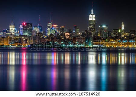 July 2012. Night view of Midtown Manhattan skyline across the Hudson River from Jersey City, NJ. - stock photo