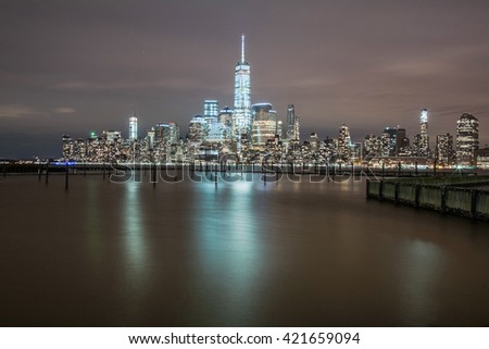 July 2012. Night view of the residential towers at waterfront of Newport section of Jersey City and their reflections in the Hudson river as seen from Hoboken, NJ. - stock photo