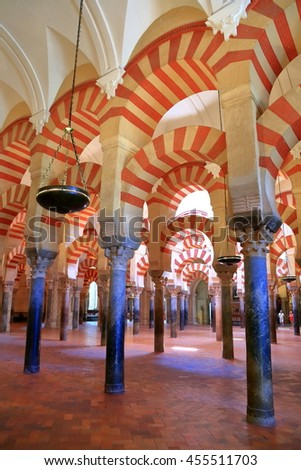 July 12, 2015: Row of Moorish arches inside the Cathedral (Mosque / Mezquita) in Cordoba, Andalusia, Spain