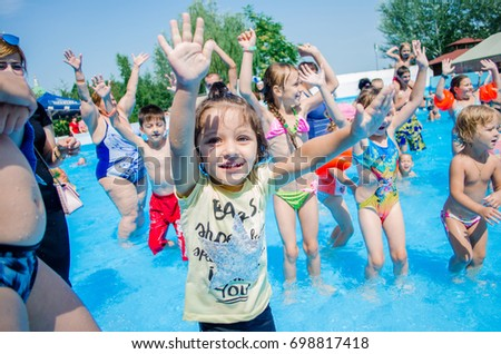 July 23, 2017. Russia. Rostov-on-Don. Children and adults exercise in the pool with blue water.