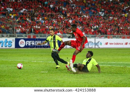July 24, 2015- Shah Alam, Malaysia: Liverpool's Dovock Origi (red) shoots at goal in a friendly match against the Malaysian Team. Liverpool Football Club from England is on an Asia tour.