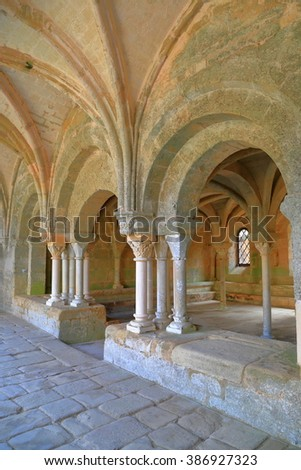July 16, 2015: Stone arches decorate the cloister and hall of the Fontfroide Abbey, Languedoc-Roussillon, France