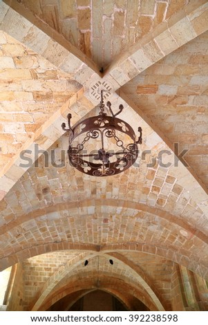 July 16, 2015: Stone arches on a ceiling inside Fontfroide Abbey, Languedoc-Roussillon, France