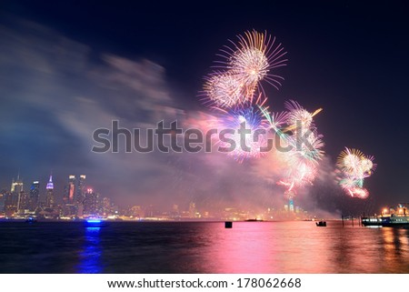 July 4th fireworks show of New York City with Manhattan midtown skyline over Hudson River. - stock photo