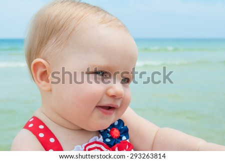 July 4th Patriotic Baby Girl at the Beach - stock photo