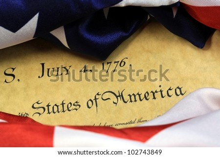 July 4, 1776 - United States of America Constitution and USA Flag.