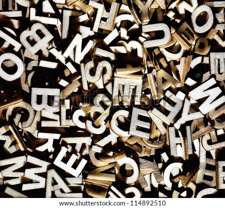 Jumbled letters made of wood close up - stock photo