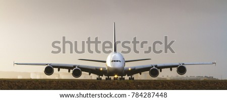Jumbo A380 airliner in front view