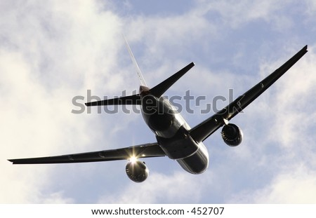 Jumbo in partial silhouette - stock photo