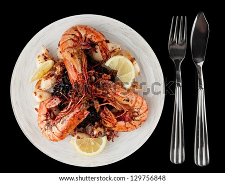 Jumbo prawns and grilled squids with black rice isolated on white background - stock photo
