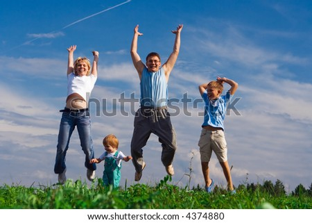 jump happy family on blue sky