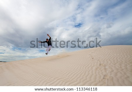 Jump in Lancelin sand dunes, We Australia - stock photo