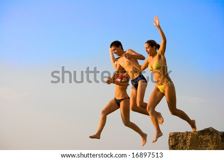 jump into the water pier with two girls and boys
