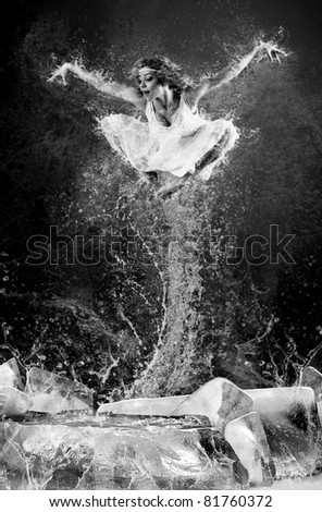 Jump of ballerina on the ice dancepool around splashes of water drops