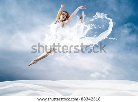 Jump of ballerina with dress of milk - stock photo