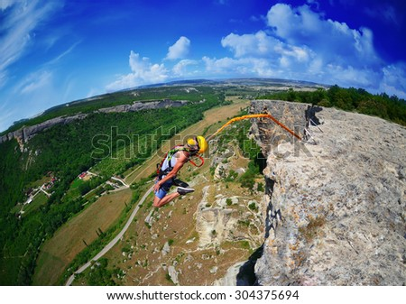 Jump off a cliff with a rope . Crimea. Kachy-Kalion.  - stock photo