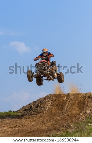 Jump on the ATV - extreme sports - stock photo