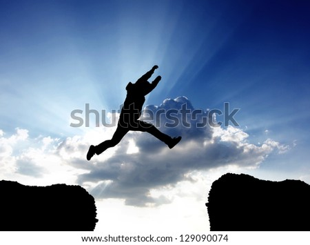 jumping a gap in sky - stock photo