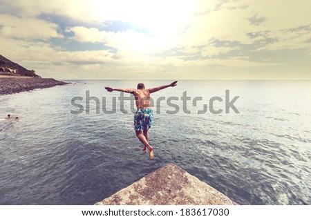 Jumping boy - stock photo