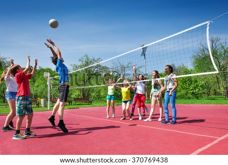Jumping boy during volleyball game on the court