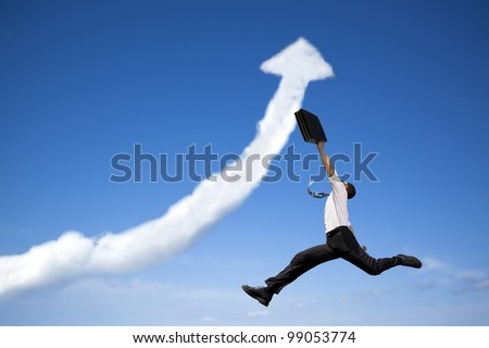 jumping businessman with business growing graph  cloud - stock photo