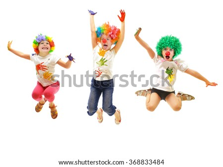 Jumping children wearing clowns costumes - stock photo