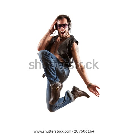 jumping dancer with headphones - stock photo