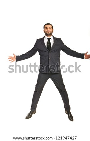 Jumping executive man isolated on white background