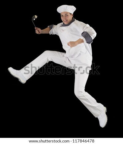 jumping female chef - stock photo