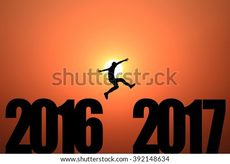 jumping from 2016 to 2017 in sunrise background - stock photo