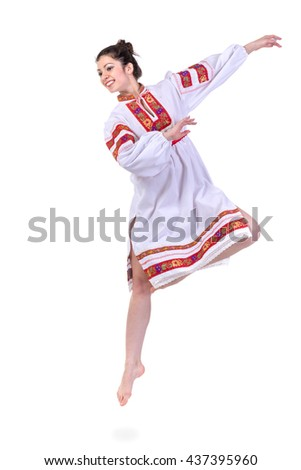 jumping girl in polish national traditional costume, full length portrait against isolated white background - stock photo