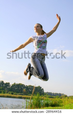 jumping girl in the sky on nature
